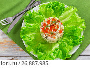 Купить «portion of olivier salad with red caviar on white plate», фото № 26887985, снято 2 октября 2018 г. (c) Oksana Zh / Фотобанк Лори