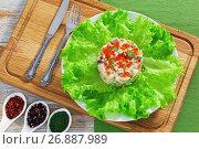 Купить «portion of olivier salad with red caviar on white plate», фото № 26887989, снято 22 ноября 2018 г. (c) Oksana Zh / Фотобанк Лори