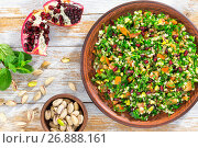 Купить «tasty tabbouleh salad with pomegranate, pistachio nuts, parsley, peppermint», фото № 26888161, снято 18 января 2019 г. (c) Oksana Zh / Фотобанк Лори