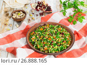 Купить «tabbouleh salad with pomegranate, pistachio nuts, parsley, peppermint», фото № 26888165, снято 18 января 2019 г. (c) Oksana Zh / Фотобанк Лори