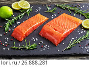 Купить «salmon fillet with fresh rosemary and drops of olive oil», фото № 26888281, снято 17 января 2019 г. (c) Oksana Zh / Фотобанк Лори