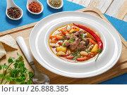 Купить «Boneless oxtail meat soup with root vegetables», фото № 26888385, снято 10 июля 2020 г. (c) Oksana Zh / Фотобанк Лори