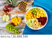 Купить «delicious fruit salad laid out on segments», фото № 26888545, снято 12 марта 2017 г. (c) Oksana Zh / Фотобанк Лори