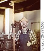 Купить «working man practicing his skills erect trestle at workshop», фото № 26891505, снято 17 января 2017 г. (c) Яков Филимонов / Фотобанк Лори