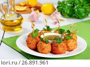 Купить «delicious fried meatballs or italian Polpette on wooden skewers on white plate with homemade sauce pesto in gravy boat and ingredients for gravy on background, close-up, front view from above», фото № 26891961, снято 19 декабря 2018 г. (c) Oksana Zh / Фотобанк Лори