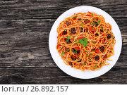Купить «paghetti with tomato sauce, capers and olives», фото № 26892157, снято 27 мая 2017 г. (c) Oksana Zh / Фотобанк Лори