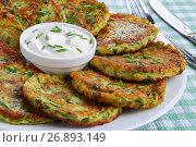 Купить «zucchini fritters on plate, top view», фото № 26893149, снято 17 сентября 2019 г. (c) Oksana Zh / Фотобанк Лори