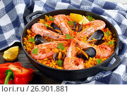 Купить «close-up of tasty seafood valencia paella», фото № 26901881, снято 21 августа 2019 г. (c) Oksana Zh / Фотобанк Лори