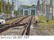 Купить «Railway tracks and bridge on crushed stone, telephoto», фото № 26907197, снято 9 сентября 2017 г. (c) Константин Шишкин / Фотобанк Лори