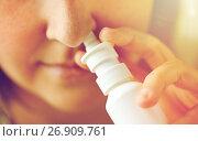 Купить «close up of sick woman using nasal spray», фото № 26909761, снято 13 октября 2016 г. (c) Syda Productions / Фотобанк Лори