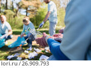 volunteer with trash bag and bottle cleaning area. Стоковое фото, фотограф Syda Productions / Фотобанк Лори