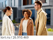 Купить «group of people talking on city street», фото № 26910469, снято 13 мая 2017 г. (c) Syda Productions / Фотобанк Лори