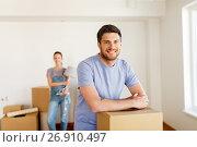 Купить «happy couple with boxes moving to new home», фото № 26910497, снято 4 июня 2017 г. (c) Syda Productions / Фотобанк Лори
