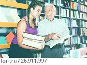 grandfather and girl discuss a book. Стоковое фото, фотограф Яков Филимонов / Фотобанк Лори