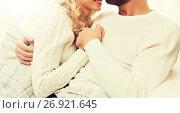 Купить «close up of happy couple cuddling at home», фото № 26921645, снято 8 октября 2015 г. (c) Syda Productions / Фотобанк Лори