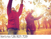 Купить «happy young couple throwing autumn leaves in park», фото № 26921729, снято 9 октября 2016 г. (c) Syda Productions / Фотобанк Лори