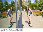 Купить «happy teenage girl riding on longboard in summer», фото № 26921889, снято 17 июня 2017 г. (c) Syda Productions / Фотобанк Лори