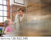 Купить «Librarian with elementary school student», фото № 26922345, снято 22 ноября 2019 г. (c) Wavebreak Media / Фотобанк Лори