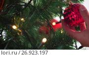 Купить «hand decorating christmas tree with ball», видеоролик № 26923197, снято 9 сентября 2017 г. (c) Syda Productions / Фотобанк Лори