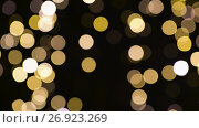 Купить «blurred chtistmas lights over dark background», видеоролик № 26923269, снято 9 сентября 2017 г. (c) Syda Productions / Фотобанк Лори