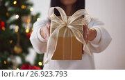 Купить «woman holding christmas gift box», видеоролик № 26923793, снято 11 сентября 2017 г. (c) Syda Productions / Фотобанк Лори