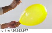 Купить «hands with pin blowing air balloon out», видеоролик № 26923977, снято 9 сентября 2017 г. (c) Syda Productions / Фотобанк Лори