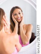 Купить «woman examining her face by looking at it in mirror», фото № 26924677, снято 6 декабря 2019 г. (c) Яков Филимонов / Фотобанк Лори