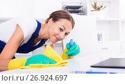 Купить «woman cleaning in company office», фото № 26924697, снято 21 июля 2018 г. (c) Яков Филимонов / Фотобанк Лори