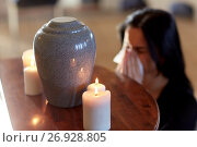 Купить «woman with cremation urn at funeral in church», фото № 26928805, снято 20 марта 2017 г. (c) Syda Productions / Фотобанк Лори