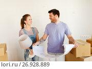 Купить «couple with boxes and blueprint moving to new home», фото № 26928889, снято 4 июня 2017 г. (c) Syda Productions / Фотобанк Лори