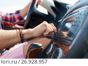 Купить «man driving car and turning switch on dashboard», фото № 26928957, снято 27 июля 2017 г. (c) Syda Productions / Фотобанк Лори