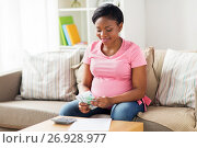 Купить «happy pregnant woman counting money at home», фото № 26928977, снято 4 августа 2017 г. (c) Syda Productions / Фотобанк Лори