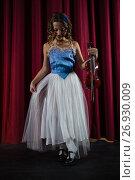Купить «Female artist with violin standing on stage», фото № 26930009, снято 20 апреля 2017 г. (c) Wavebreak Media / Фотобанк Лори