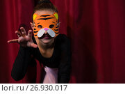 Купить «Ballet dancer wearing mask crawling», фото № 26930017, снято 20 апреля 2017 г. (c) Wavebreak Media / Фотобанк Лори