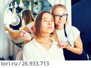 Купить «Woman makeup artist applying cosmetics for female», фото № 26933713, снято 11 августа 2017 г. (c) Яков Филимонов / Фотобанк Лори