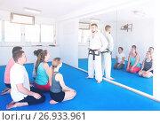 Купить «Coach will give instructions before training on karate», фото № 26933961, снято 8 апреля 2017 г. (c) Яков Филимонов / Фотобанк Лори
