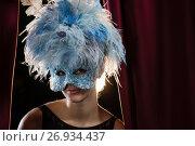 Купить «Woman wearing masquerade mask and wig», фото № 26934437, снято 20 апреля 2017 г. (c) Wavebreak Media / Фотобанк Лори