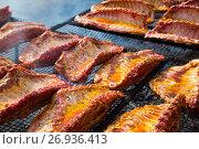 Купить «Meat ribs of pig roasting on barbecue», фото № 26936413, снято 30 апреля 2017 г. (c) Яков Филимонов / Фотобанк Лори