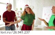 Купить «team dancing at christmas corporate office party», видеоролик № 26941237, снято 6 сентября 2017 г. (c) Syda Productions / Фотобанк Лори