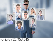 Купить «Businessman wearing Virtual reality headset interacting and choosing a person from group of people i», фото № 26953645, снято 16 июля 2019 г. (c) Wavebreak Media / Фотобанк Лори