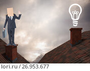 Light bulb icon and Businessman standing on Roofs with chimney and cardboard box on his head and dra. Стоковое фото, агентство Wavebreak Media / Фотобанк Лори