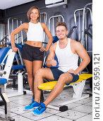 Купить «happy young man and woman taking pause between exercising in gym», фото № 26959121, снято 8 декабря 2019 г. (c) Яков Филимонов / Фотобанк Лори