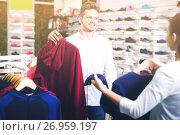 Купить «Glad loving couple deciding on new sportswear», фото № 26959197, снято 22 ноября 2016 г. (c) Яков Филимонов / Фотобанк Лори
