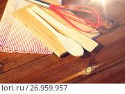 Купить «close up of cooking kitchenware on wooden board», фото № 26959957, снято 1 октября 2015 г. (c) Syda Productions / Фотобанк Лори