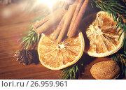 Купить «christmas fir branch, cinnamon and dried orange», фото № 26959961, снято 1 октября 2015 г. (c) Syda Productions / Фотобанк Лори