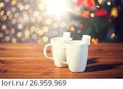 Купить «cups of hot chocolate with marshmallow on wood», фото № 26959969, снято 1 октября 2015 г. (c) Syda Productions / Фотобанк Лори