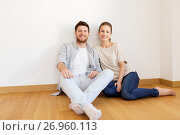 Купить «happy couple at empty room of new home», фото № 26960113, снято 4 июня 2017 г. (c) Syda Productions / Фотобанк Лори