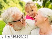 Купить «senior grandparents and granddaughter at park», фото № 26960161, снято 9 августа 2017 г. (c) Syda Productions / Фотобанк Лори