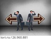 Купить «Left or right arrows with bulbs with Businessman looking in opposite directions», фото № 26960881, снято 26 сентября 2018 г. (c) Wavebreak Media / Фотобанк Лори