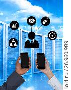 Купить «Business people holding phones and graphics in server room», фото № 26960989, снято 20 ноября 2018 г. (c) Wavebreak Media / Фотобанк Лори
